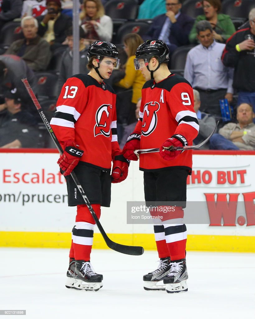 New Jersey Devils center Nico Hischier (13) talks with teammate New Jersey Devils left wing Taylor Hall (9) during the first period of the National Hockey League game between the New Jersey Devils and the Columbus Blue Jackets on February 20, 2018, at the Prudential Center in Newark, NJ.
