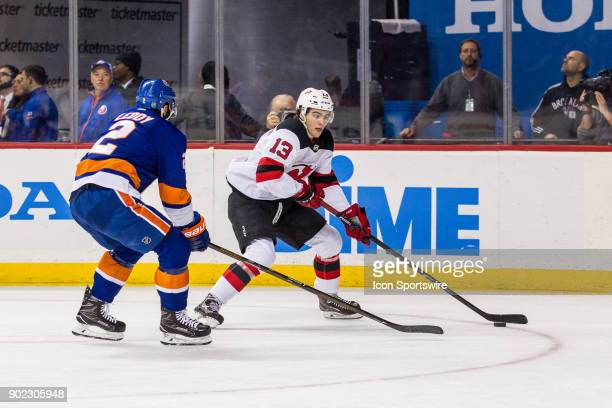 New Jersey Devils Center Nico Hischier works the puck around New Jersey Devils Defenceman John Moore during the first period of a Metropolitan...