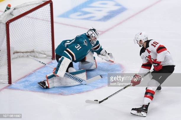 New Jersey Devils Center Travis Zajac has a shot blocked by San Jose Sharks Goalie Martin Jones during the National Hockey League game between the...