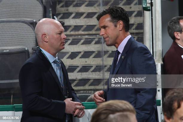 New Jersey Devils coach John Hynes and New York Rangers coach David Quinn chat during the 2018 NHL Draft at American Airlines Center on June 23 2018...