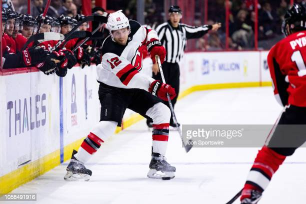 New Jersey Devils Defenceman Ben Lovejoy shoots the puck during third period National Hockey League action between the New Jersey Devils and Ottawa...