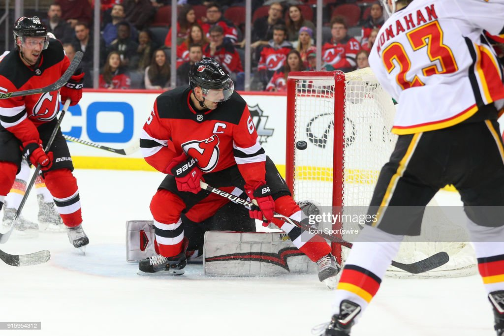 New Jersey Devils defenseman Andy Greene (6) and New Jersey Devils goaltender Keith Kinkaid (1) cant stop a goal by Calgary Flames center Sean Monahan (23) during the second period of the National Hockey League game between the New Jersey Devils and the Calgary Flames on February 8, 2018, at the Prudential Center in Newark, NJ.