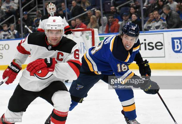 New Jersey Devils defenseman Andy Greene and St Louis Blues center Robert Thomas go after a loose puck during an NHL game between the New Jersey...