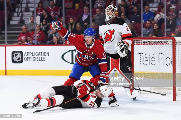 New Jersey Devils defenseman Ben Lovejoy holds onto Montreal Canadiens right wing Brendan Gallagher stick in front of New Jersey Devils goalie Eddie...