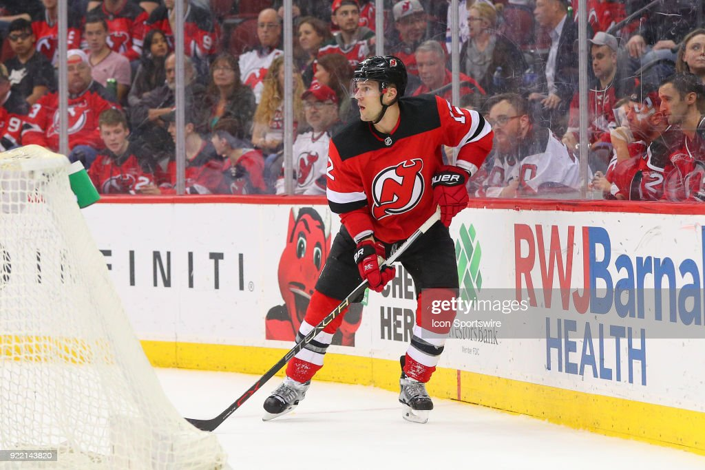 New Jersey Devils defenseman Ben Lovejoy (12) skates during the second period of the National Hockey League game between the New Jersey Devils and the Columbus Blue Jackets on February 20, 2018, at the Prudential Center in Newark, NJ.
