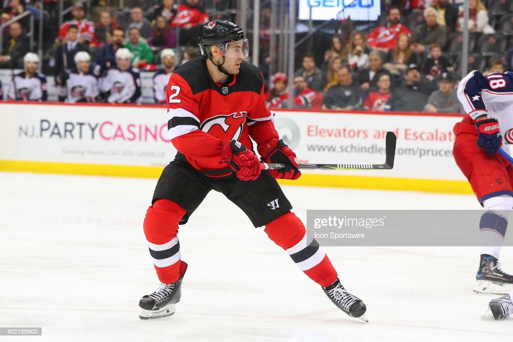 New Jersey Devils defenseman John Moore (2) skates during the third period of the National Hockey League game between the New Jersey Devils and the Columbus Blue Jackets on February 20, 2018, at the Prudential Center in Newark, NJ.