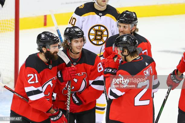New Jersey Devils defenseman Ty Smith is all smiles with teammates New Jersey Devils center Jack Hughes , New Jersey Devils right wing Kyle Palmieri...