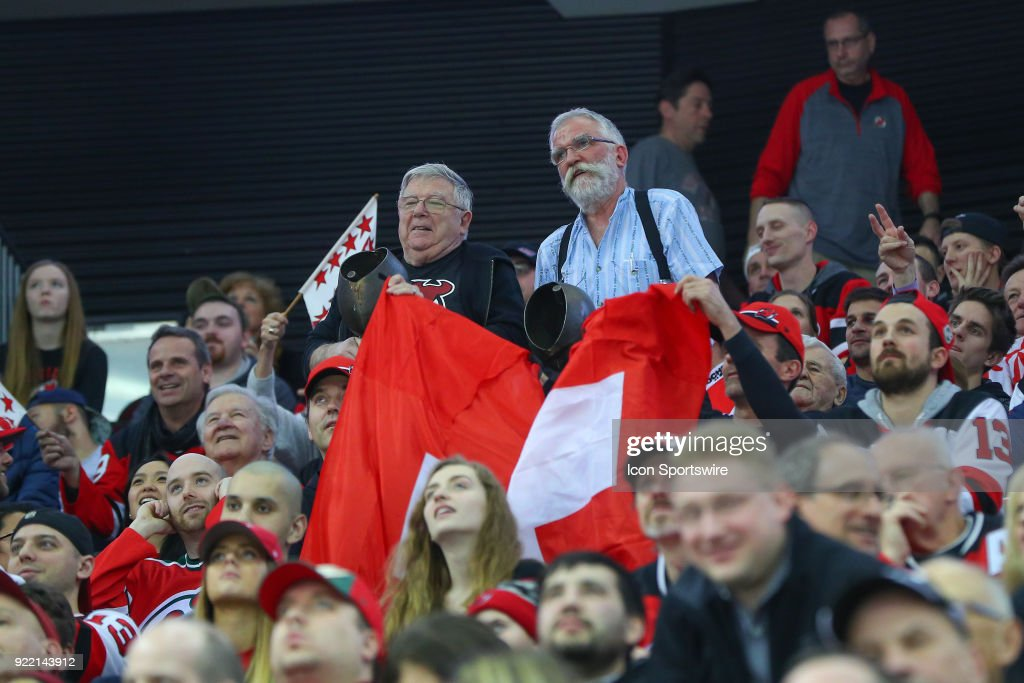 New Jersey Devils Fans with Bells and a Swiss Flag during the third period of the National Hockey League game between the New Jersey Devils and the Columbus Blue Jackets on February 20, 2018, at the Prudential Center in Newark, NJ.