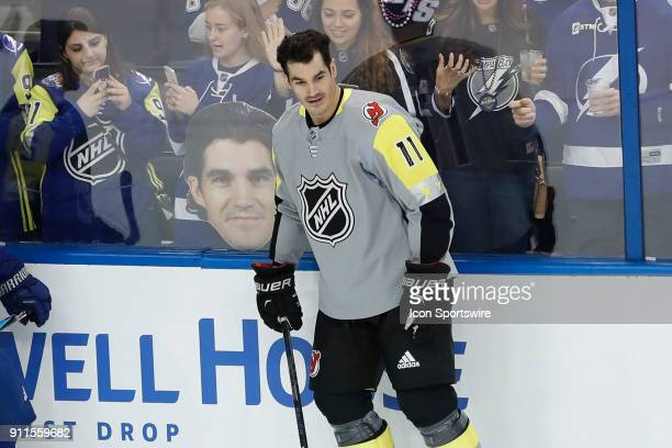 New Jersey Devils forward Brian Boyle skates infant of a giant photo of his face during warm ups before the 2018 NHL AllStar Game on January 28 2018...