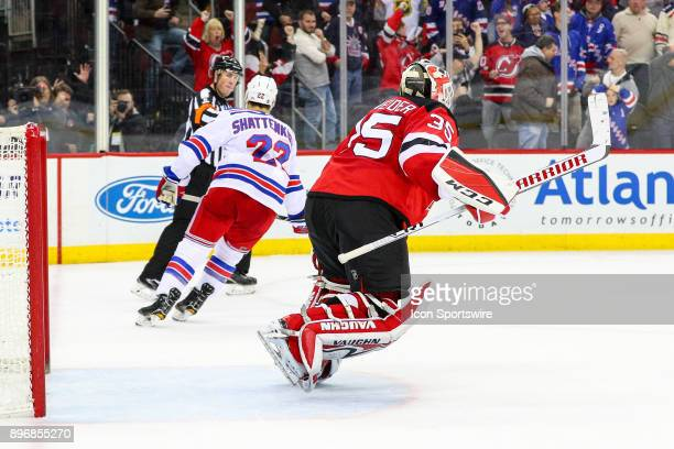 New Jersey Devils goalie Cory Schneider celebrates after stopping New York Rangers defenseman Kevin Shattenkirk during the shootout of the National...