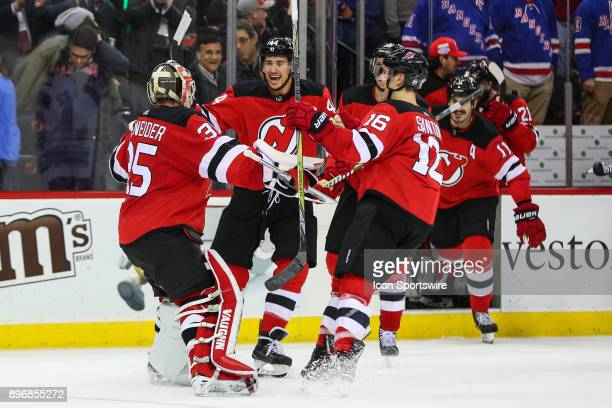 New Jersey Devils goalie Cory Schneider celebrates with teammates after stopping New York Rangers defenseman Kevin Shattenkirk during the shootout of...