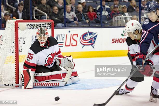 New Jersey Devils goalie Cory Schneider focuses on a shot from Columbus Blue Jackets right wing Josh Anderson during a game between the Columbus Blue...