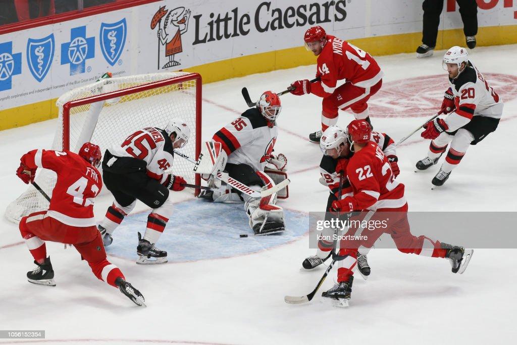 half off 96fcb 4d1a9 New Jersey Devils goalie Cory Schneider kicks the puck away ...