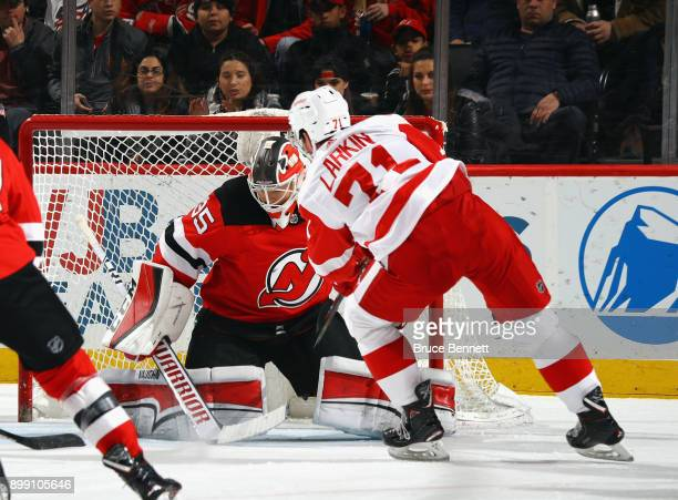 New Jersey Devils goalie Cory Schneider makes the first period save on Detroit Red Wings center Dylan Larkin at the Prudential Center on December 27...