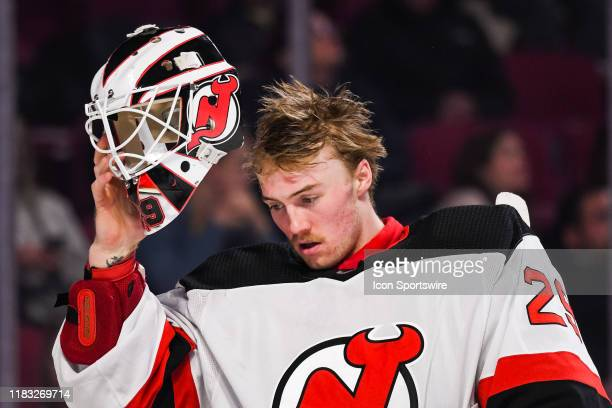 New Jersey Devils goalie Mackenzie Blackwood pulls his mask off during the New Jersey Devils versus the Montreal Canadiens game on November 16 at...