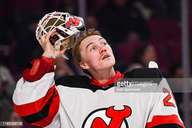 New Jersey Devils goalie Mackenzie Blackwood puts his mask back during the New Jersey Devils versus the Montreal Canadiens game on November 16 at...