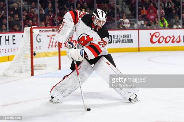 New Jersey Devils goalie Mackenzie Blackwood stops the puck far away from his net during the New Jersey Devils versus the Montreal Canadiens game on...