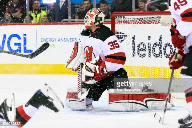 New Jersey Devils goaltender Cory Schneider gives up a goal in the second period against the Washington Capitals on December 30 at the Capital One...