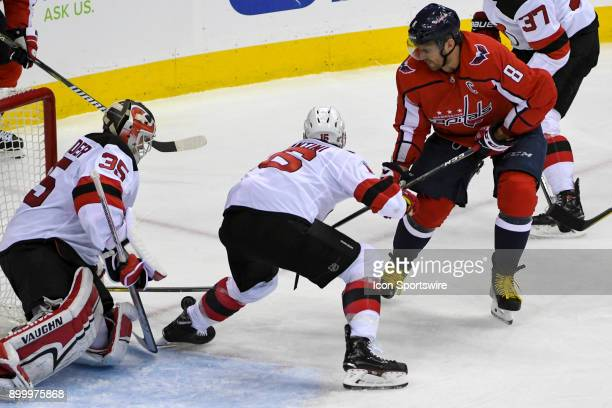 New Jersey Devils goaltender Cory Schneider makes a save on shot by Washington Capitals left wing Alex Ovechkin in the third period on December 30 at...