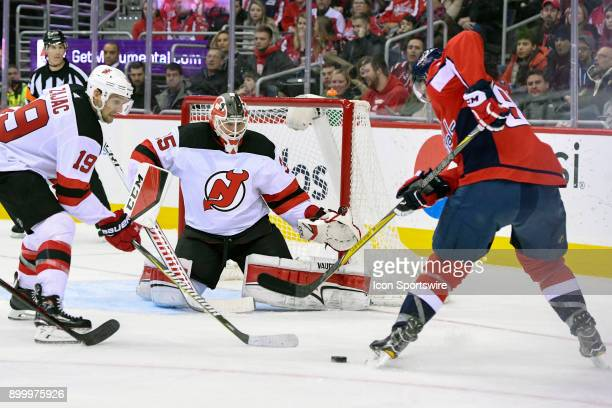 New Jersey Devils goaltender Cory Schneider makes a second period save on shot by Washington Capitals center Evgeny Kuznetsov on December 30 at the...