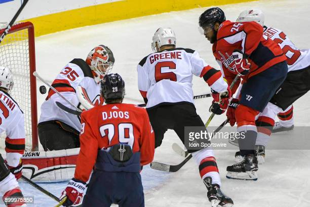 New Jersey Devils goaltender Cory Schneider makes a third period save on a shot by Washington Capitals right wing Devante SmithPelly on December 30...