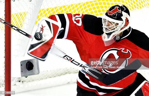 New Jersey Devils' goaltender Martin Brodeur makes a glove save off a shot by the New York Rangers in the 1st period of Game 2 of the NHL Playoffs at...