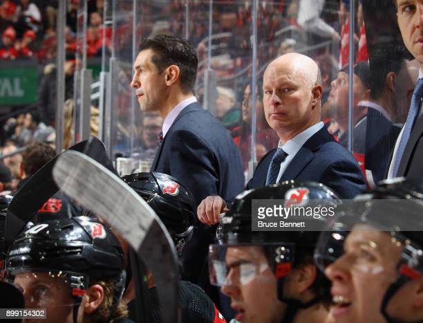 New Jersey Devils head coach John Hynes works his 200th NHL game against the Detroit Red Wings at the Prudential Center on December 27 2017 in Newark...
