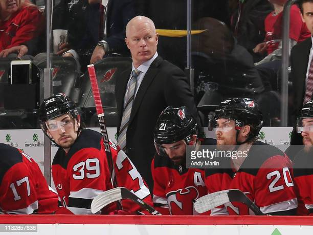 New Jersey Devils head coack John Hynes looks on during the third period against the Buffalo Sabres at the Prudential Center on March 25 2019 in...