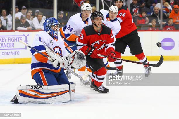 New Jersey Devils left wing Brett Seney and New York Islanders goaltender Thomas Greiss during the National Hockey League game between the New Jersey...