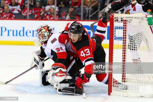 New Jersey Devils left wing Brett Seney collides with Ottawa Senators goaltender Anders Nilsson during the second period of the National Hockey...