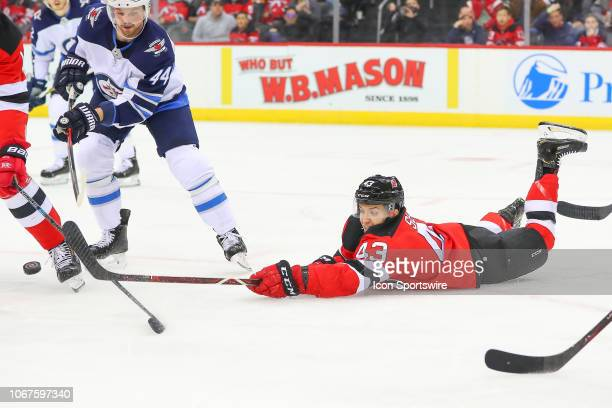 New Jersey Devils left wing Brett Seney dives for the puck during the second period of the National Hockey League Game between the New Jersey Devils...
