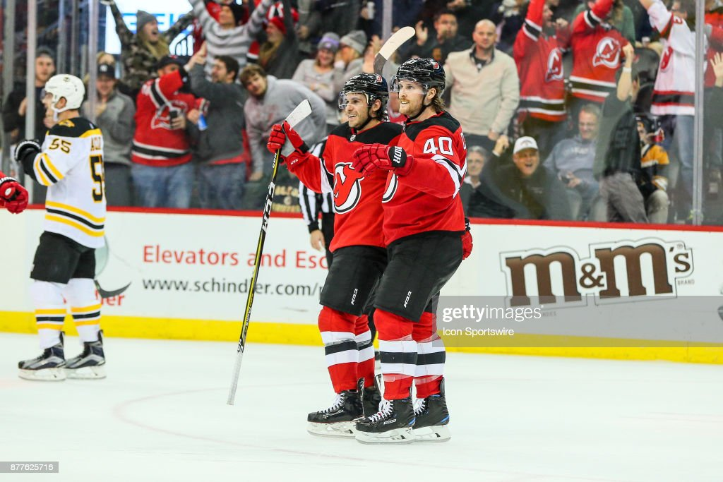 New Jersey Devils left wing Brian Gibbons celebrates with teammate ... 312903f53