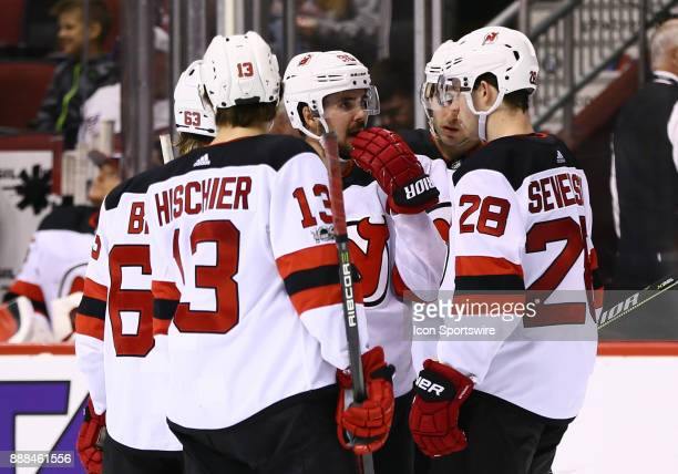 New Jersey Devils left wing Marcus Johansson talks strategy with his team during the NHL hockey game between the New Jersey Devils and the Arizona...