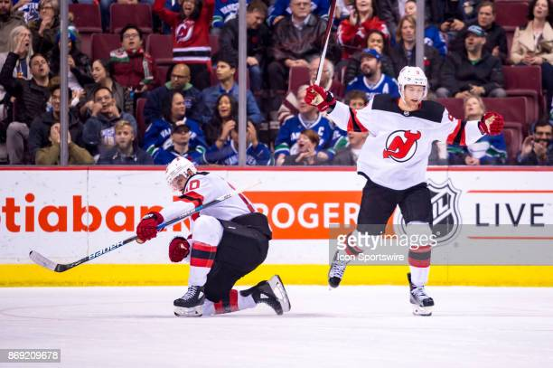 New Jersey Devils Left Wing Taylor Hall celebrates with New Jersey Devils Right Wing Jimmy Hayes after he scored New Jersey Devils first goal during...