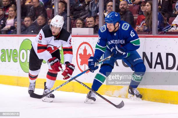 New Jersey Devils Left Wing Taylor Hall defends against Vancouver Canucks Right Wing Derek Dorsett during their NHL game at Rogers Arena on November...