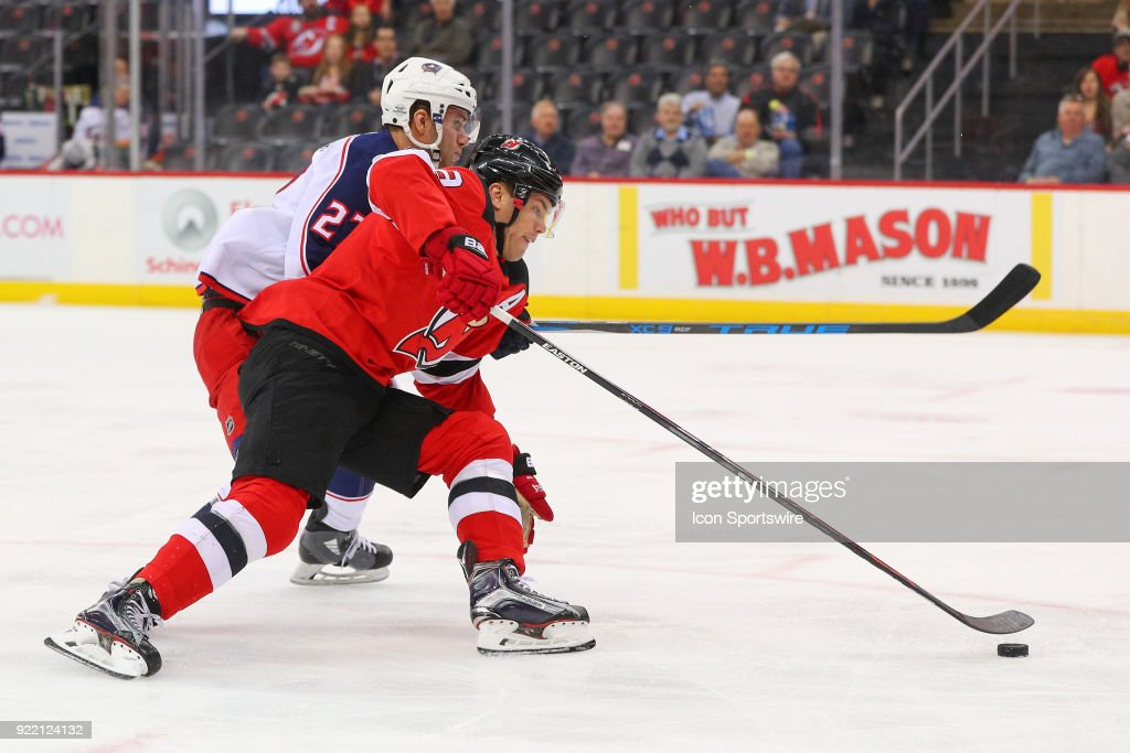 New Jersey Devils left wing Taylor Hall (9) drives the net during the first period of the National Hockey League game between the New Jersey Devils and the Columbus Blue Jackets on February 20, 2018, at the Prudential Center in Newark, NJ.