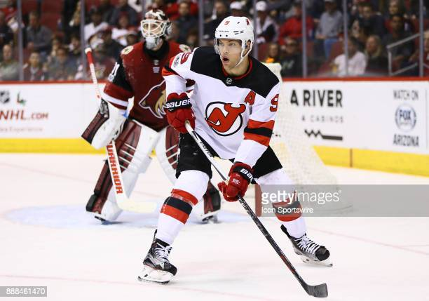 New Jersey Devils left wing Taylor Hall sets up near the goal during the NHL hockey game between the New Jersey Devils and the Arizona Coyotes on...