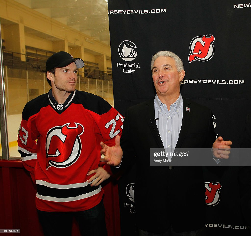 New Jersey Devils owner Jeff Vanderbeek (R) addresses the kids as David Clarkson looks on during the Hockey in Newark instructional clinic on February 13, 2013 in Newark, New Jersey.