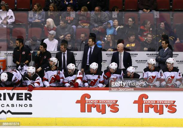 New Jersey Devils players and staff watch the action during the NHL hockey game between the New Jersey Devils and the Arizona Coyotes on December 2...