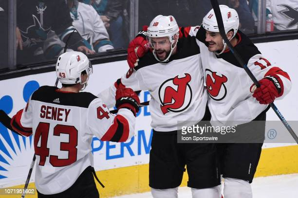 New Jersey Devils Right Wing Drew Stafford celebrates after scoring his side's first goal with teammates New Jersey Devils Center Brett Seney and New...