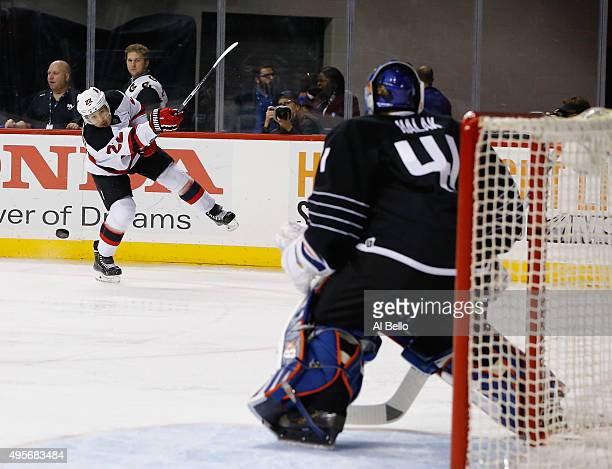 New Jersey Devils right wing Jordin Tootoo shoots against New York Islanders goalie Jaroslav Halak during their game at Barclays Center on November 3...