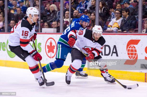 New Jersey Devils Winger Brian Gibbons is pursued by Vancouver Canucks Right Wing Thomas Vanek during their NHL game at Rogers Arena on November 1...