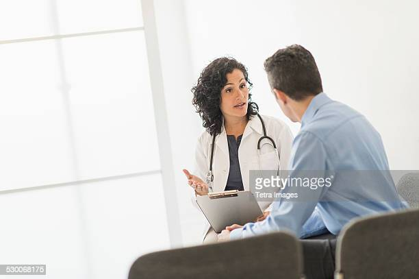 usa, new jersey, doctor talking to patient - outpatient care stock pictures, royalty-free photos & images