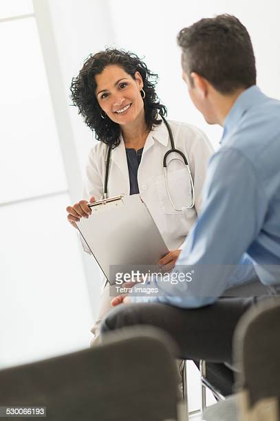 USA, New Jersey, Doctor talking with patient