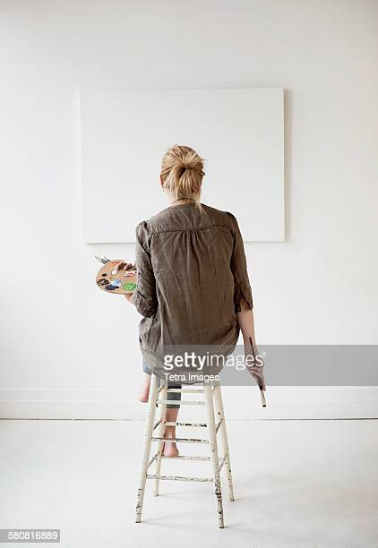 USA, New Jersey, Female artist painting in studio