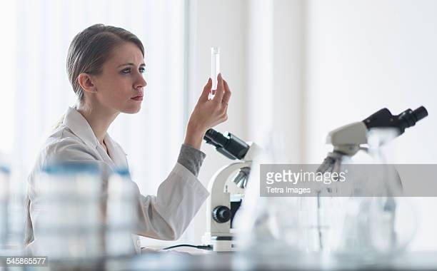 USA, New Jersey, Female lab technician examining liquid in test tube