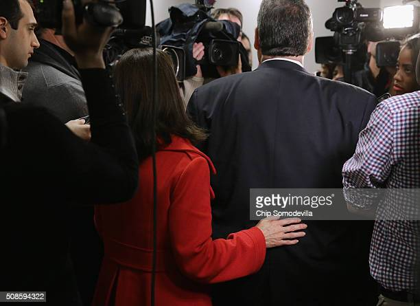 New Jersey first lady Mary Pat Christie keeps her hand on her husband Governor and Republican presidential candidate Chris Christie's back as he...