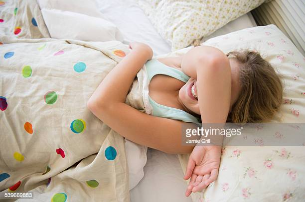 usa, new jersey, girl (12-13) lying in bed covering her face - funny wake up stock pictures, royalty-free photos & images