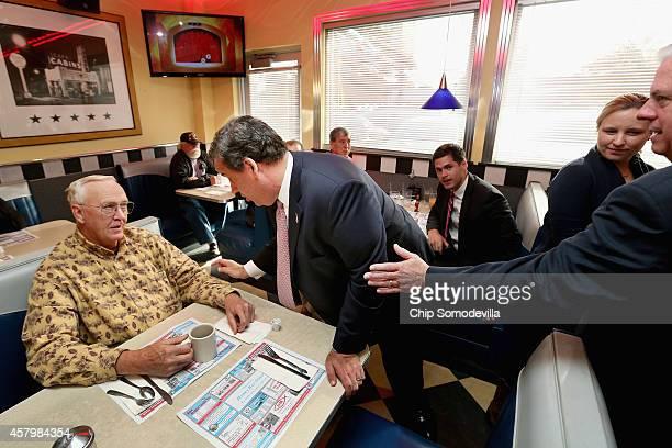 New Jersey Gov. Chris Christie and John Crispens of Pasadena, Maryland, have a quick debate as Maryland Republican gubernatorial candidate Larry...