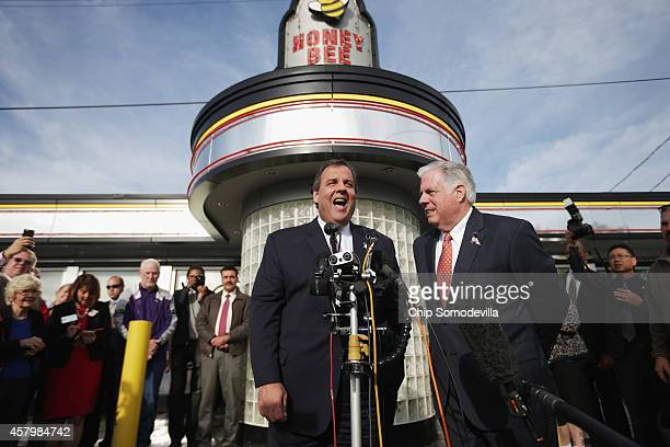New Jersey Gov. Chris Christie and Maryland Republican gubernatorial candidate Larry Hogan talk to reporters during a campaign stop outside the Honey...
